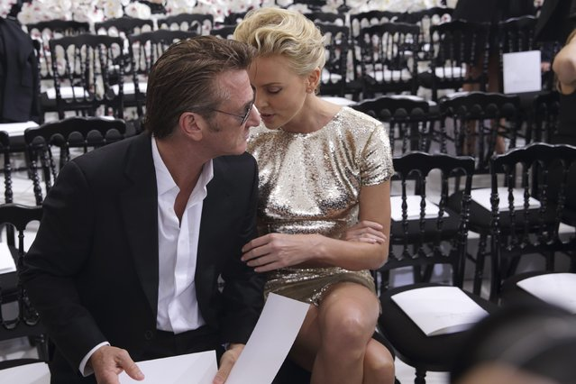 Actors Sean Penn (L) and Charlize Theron speak together prior to the French fashion house Christian Dior Haute Couture Fall/Winter 2014-2015 fashion show by Belgian designer Raf Simons in Paris July 7, 2014. (Photo by Philippe Wojazer/Reuters)