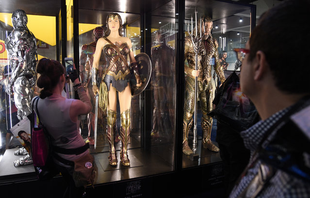 Comic-Con attendees pass by a life-size Wonder Woman statue during Preview Night of the 2017 Comic-Con International on Wednesday, July 19, 2017, in San Diego, Calif. (Photo by Chris Pizzello/Invision/AP Photo)