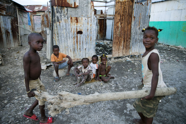 In this December 3, 2019 photo, children play near their home in the Cite Soleil slum of Port-au-Prince, Haiti. According to a joint statement by humanitarian organizations, an estimated 3.7 million Haitians require emergency food assistance. (Photo by Dieu Nalio Chery/AP Photo)
