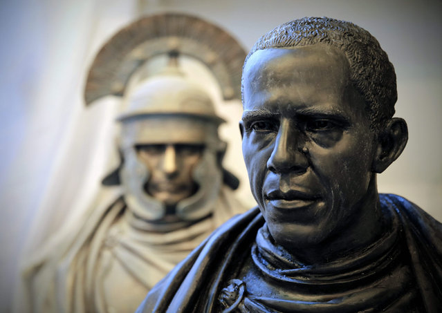Gypsum busts of Russian President Vladimir Putin (L) and US President Barack Obama are on display in the workshop of Russian sculptor Pavel Greshnikov in St. Petersburg, Russia, 13 August 2015. The final bronze busts will depict Putin and Obama as Roman Emperors in an exhibition by Greshnikov. (Photo by Anatoly Maltsev/EPA)