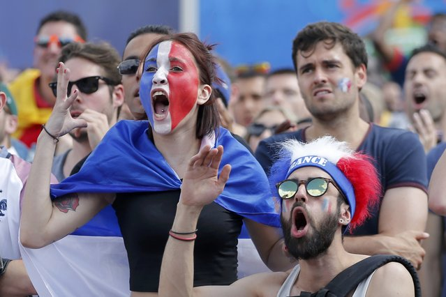 France fans react as they watch the France v Republic of Ireland EURO 2016 Round of 16 soccer match at the fan zone in Paris, France, June 26, 2016. (Photo by Stephane Mahe/Reuters)