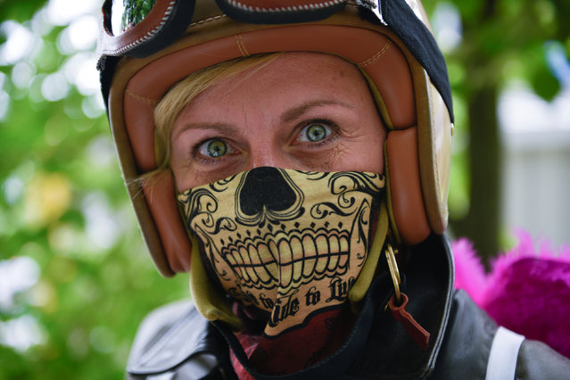 A woman poses during a motorbike ride out at the women-only Petrolettes motorcycle festival in Neuhardenberg near Berlin, Germany on July 29, 2017. (Photo by Stefanie Loos/Reuters)