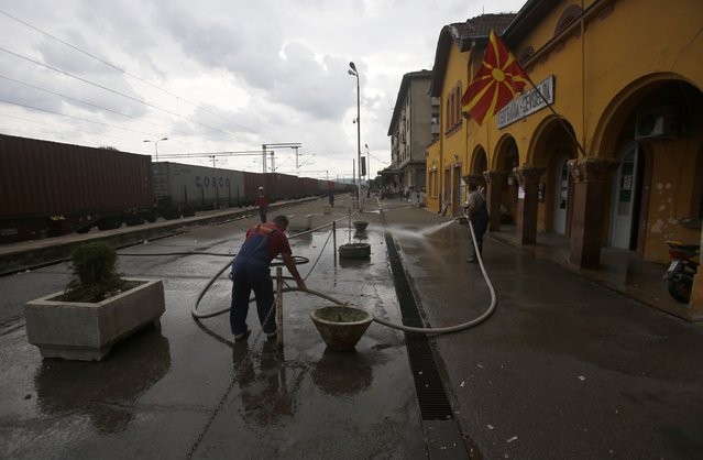 Workers are cleaning the railway station in the southern Macedonian town of Gevgelija, Thursday, August 20, 2015. (Photo by Darko Vojinovic/AP Photo)