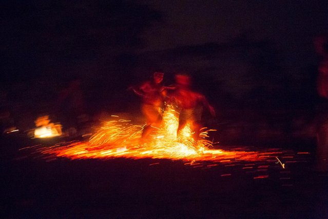 Men walk on embers during a ritual at the Sorte Mountain on the outskirts of Chivacoa, in the state of Yaracuy, Venezuela October 11, 2015. (Photo by Marco Bello/Reuters)