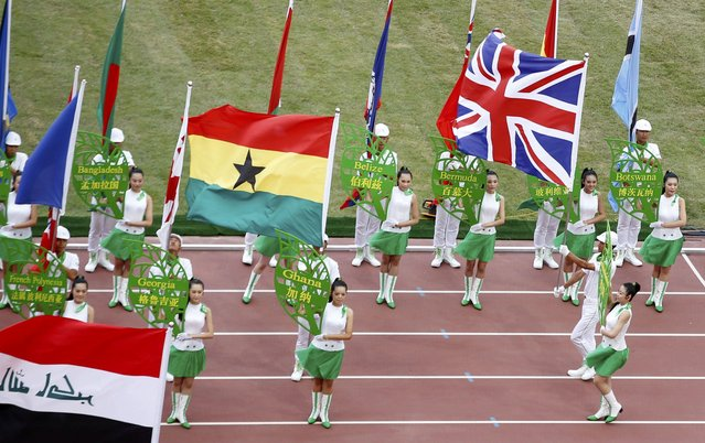 Performers parade with flags of particpating nations during the opening ceremony of the 15th IAAF World Championships at the National Stadium in Beijing, China August 22, 2015. (Photo by Fabrizio Bensch/Reuters)