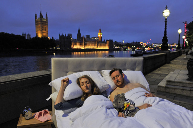 "Londoners enjoy a ""Silent Night"" as Big Ben falls silent, London, UK on August 21, 2017. Londoners snuggle up to enjoy the city's first silent night as Big Ben chimed its last for four years. As the sun set over London last night the city bid a temporary farewell to the chimes of its beloved Big Ben. Londoners were testing out the new quiet of the Southbank in an unusual fashion. A luxurious bed, courtesy of bed firm, Silentnight, complete with fluffy white duvet, plump pillows, a hot water bottle and a cuddly toy, emerged in the heart of the city, just in time for bed. It didn't take local residents and workers long to make the most of the peace and quiet with the city's tired workers climbing in for a nap. Rose Allerston from Clapham, London said ""After a stressful day in the office, I couldn't think of anything better than going home and climbing into bed - but when I saw this bed opposite Big Ben I just couldn't resist getting in for a snuggle"". (Photo by Imagewise Ltd/Rex Features/Shutterstock)"