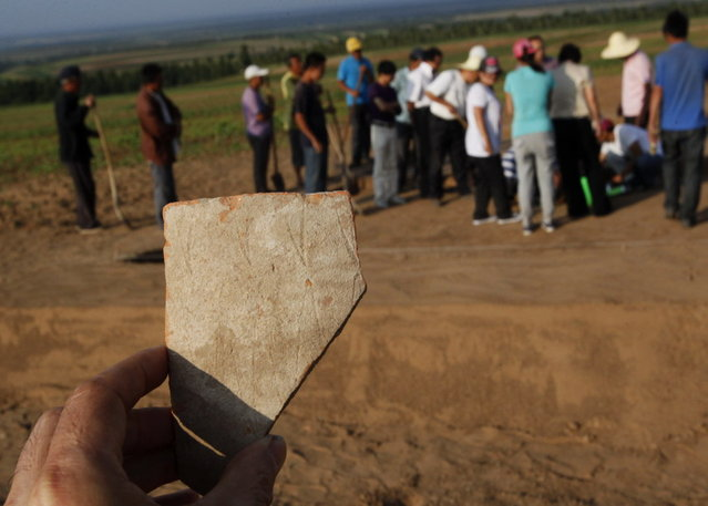 A piece of the pottery statue found in Aohan Banner, North China's Inner Mongolia autonomous region, July 3, 2012. (Photo by Xinhua)