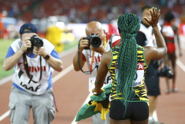 Shelly-Ann Fraser-Pryce of Jamaica celebrates after winning gold in the women's 100 metres final during the 15th IAAF World Championships at the National Stadium in Beijing, China August 24, 2015. (Photo by Kai Pfaffenbach/Reuters)
