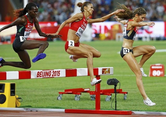 Hyvin Kiyeng Jepkemoi of Kenya (L), Habiba Ghribi of Tunisia and Gesa Felicitas Krause of Germany (R) clear an obstacle while competing in the women's 3,000 metres steeplechase final during the 15th IAAF World Championships at the National Stadium in Beijing, China August 26, 2015. (Photo by Damir Sagolj/Reuters)