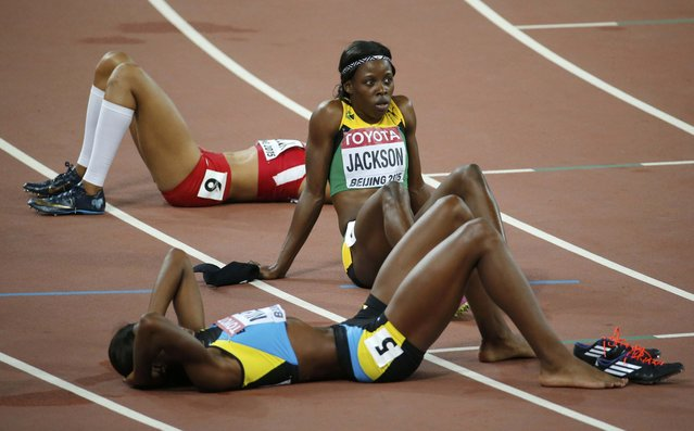 Shericka Jackson of Jamaica sits on the track after the women's 400 metres final during the 15th IAAF World Championships at the National Stadium in Beijing, China August 27, 2015. (Photo by Fabrizio Bensch/Reuters)