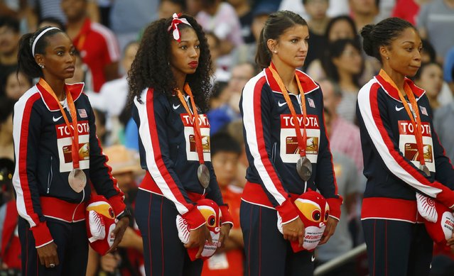 Allyson Felix of the U.S. (R) and teammates Jenna Prandini (2ndR), Jasmine Todd (2ndL) and English Gardener (L), silver medallists, pose on the podium after the women's 4 x 100 metres relay event during the 15th IAAF World Championships at the National Stadium in Beijing, China, August 30, 2015. (Photo by Kai Pfaffenbach/Reuters)