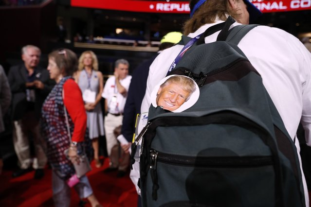 Trump supporter Jake Byrd from Chino, Calf., shows support on his backpack during first day of the Republican National Convention in Cleveland, Monday, July 18, 2016. (Photo by Carolyn Kaster/AP Photo)