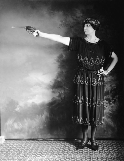 Mrs. Lee Rothan stands in a pistol-firing stance, early 20th Century (circa 1918). Rothan, of Houston, Texas, was one of the best amateur shooters in the South. (Photo by Keystone)