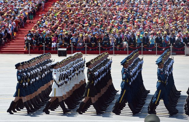 Chinese soldiers march in a military parade at Tiananmen Square in Beijing on September 3, 2015, to mark the 70th anniversary of victory over Japan and the end of World War II. China kicked off a huge military ceremony marking the 70th anniversary of Japan's defeat in World War II on September 3, as major Western leaders stayed away. (Photo by Greg Baker/AFP Photo)