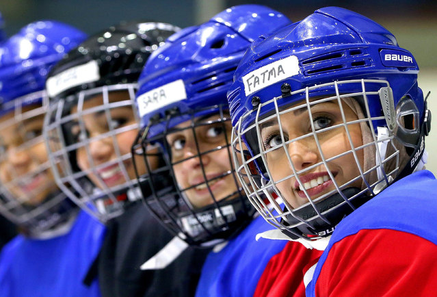 Members of Kuwait' s women' s ice hockey team take part in a training session at the ski lounge in Kuwait City on September 29, 2017. Fifty- six Kuwaiti women between the ages of 15 and 30 are now the proud owners of team jerseys emblazened with their names on the back – some of them mothers who frequently bring their children to training. (Photo by Yasser Al-Zayyat/AFP Photo)