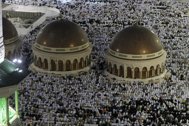 Muslim pilgrims pray near the holy Kaaba (not seen) at the Grand Mosque, during the annual Hajj pilgrimage in Mecca September 27, 2014. (Photo by Muhammad Hamed/Reuters)