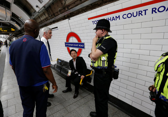London underground officials and Transport police officers speak to a man as he waits for the Night Tube train service at Tottenham Court Road on the London underground system in London, Britain August 20, 2016. (Photo by Paul Hackett/Reuters)