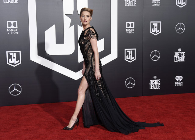 "Amber Heard, a cast member in ""Justice League"", walks the red carpet at the premiere of the film at the Dolby Theatre on Monday, November 13, 2017, in Los Angeles. (Photo by Chris Pizzello/Invision/AP Photo)"