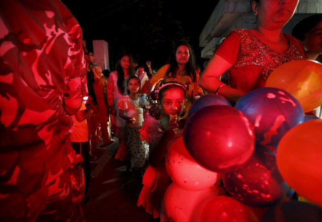 Nepalese people holding balloons walk out from the parliament after President Ram Baran Yadav promulgated the constitution at the parliament in Kathmandu, Nepal September 20, 2015. (Photo by Navesh Chitrakar/Reuters)