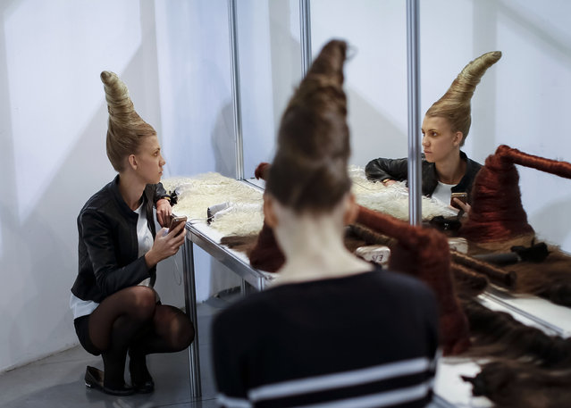 Models wait backstage during Ukrainian Fashion Week in Kiev, October 15, 2014. (Photo by Gleb Garanich/Reuters)