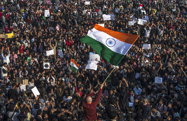 Students chant anti-police slogans during a protest against the Indian governments reaction to recent rape incidents in India in front of the Presidential Palace on December 22, 2012 in New Delhi, India. (Photo by Daniel Berehulak)
