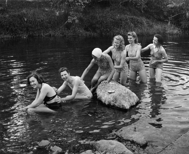A nearby stream affords this group of U.S. Army nurses stationed in New Caledonia an excellent place to swim and bathe on September 28, 1942. Swimming, hiking and hunting are virtually the only recreations available to the nurses on the island. (Photo by Wallace Kirkland/AP Photo/Life)