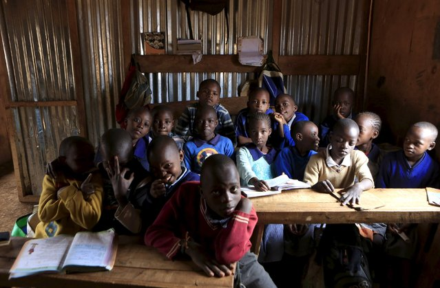 Class one children aged between six and seven years old pose for pictures in their classroom at Gifted Hands Educational Centre in Kenya's Kibera slum in the capital Nairobi, September 16, 2015. (Photo by Noor Khamis/Reuters)
