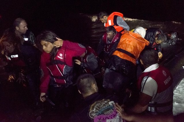 Syrian refugees arrive on an overcrowded dinghy on the Greek island of Lesbos, after crossing in rough seas from the Turkish coast, October 2, 2015. (Photo by Dimitris Michalakis/Reuters)