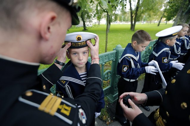 Cadets of the Kronstadt Naval Cadets College attend a ceremony of initiation into cadets in Kronstadt, outside St. Petersburg, Russia, 17 September 2016. First Naval cadets college was established in Kronstadt on the initiative of the St. Petersburg Government, on 22 November 1995. (Photo by Anatoly Maltsev/EPA)