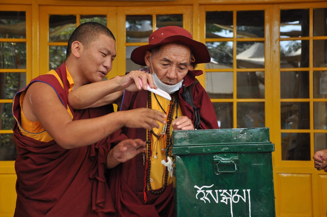 Tibetans living-in-exile cast their vote for the 16th Tibetan Parliamentary election at a polling station in Dharamsala, India, 18 October 2015.Tibetan parliamentary elections are held every five years to choose Tibetans Sikyong or Political Leader and Chithues or Members of Parliament. Harvard-educated Lobsang Sangay is the current Prime Minister of the Tibetan governemnt-in-exile. (Photo by Sanjay Baid/EPA)