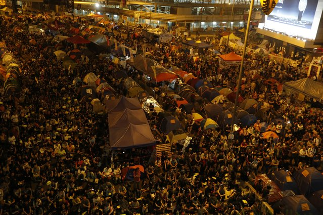 Protesters gather at the legislative council protest site in Hong Kong, November 30, 2014. (Photo by Bobby Yip/Reuters)