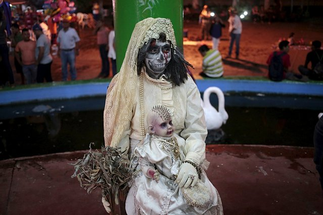 A reveller takes part in the popular annual Aguizotes festival in the indigenous community of Monimbo in Masaya, Nicaragua, October 23, 2015. (Photo by Oswaldo Rivas/Reuters)