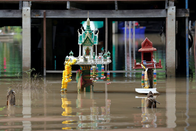 Two spirit houses are seen in a flooded-house in Sena district in the ancient tourist city of Ayutthaya, Thailand, October 5, 2016. (Photo by Chaiwat Subprasom/Reuters)