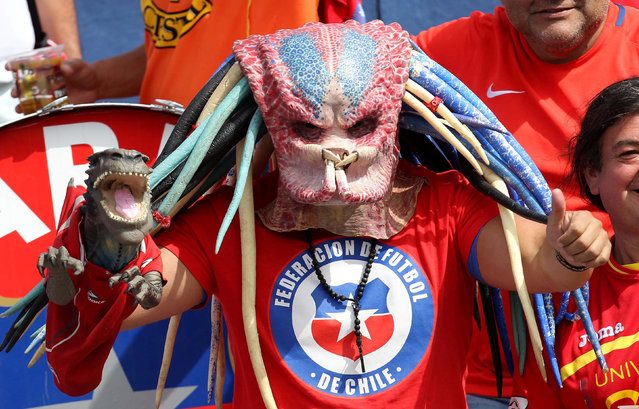 Football Soccer, Ecuador vs Chile, World Cup 2018 Qualifier, Olimpico Atahualpa Stadium, Quito, Ecuador on October 6, 2016. A fan supporting Chile wears a mask. (Photo by Guillermo Granja/Reuters)