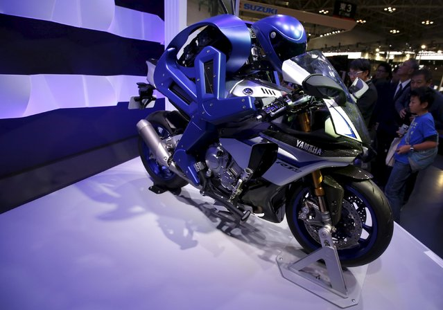 Yamaha Motor Co Ltd's displays the company's prototype model of a motorcycle riding robot 'MOTOBOT Ver. 1' at the 44th Tokyo Motor Show in Tokyo, Japan, November 2, 2015. Japanese motorcycle manufacturer Yamaha Motor showcased an autonomous 'robot motorcycle' at the motor show, where visitors stopped in their tracks to get a photo of the blue, sleek robot sitting on an equally sleek sports bike. (Photo by Issei Kato/Reuters)