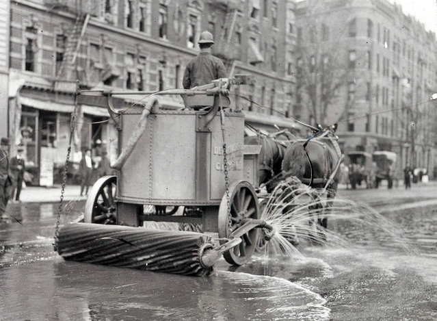 A two-horse team street cleaner, with sprayer, squeegee, and roller at rear. New York, between ca. 1910 and ca. 1915. (Photo by NYC Municipal Archives)