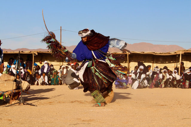 In this photo taken Saturday February 17, 2018, a man performs during a festival in Iferouane, Niger. (Photo by Ludivine Laniepce/AP Photo)