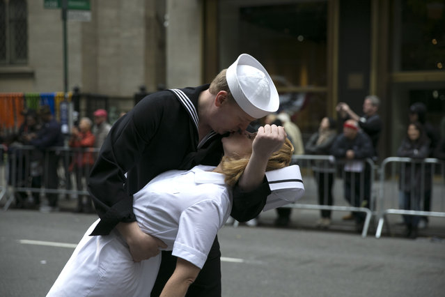 Participants reenact the iconic Alfred Eisenstaedt photograph of a sailor and nurse kissing in Times Square on V-J Day during the Veterans Day Parade in New York City on November 11, 2015. (Photo by Gordon Donovan/Yahoo News)