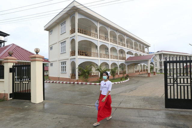 A nurse wears a mask to protect herself form the swine flu virus outside a nursing training school, Tuesday, July 25, 2017, in Naypyitaw, Myanmar. (Photo by Aung Shine Oo/AP Photo)