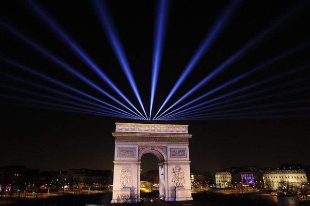 A photo taken on December 31, 2014 shows The Arc de Triomphe (Arch of Triumph) on the Champs Elysees in Paris, as the French capital waits for the New Year to ring in. (Photo by Matthieu Alexandre/AFP Photo)