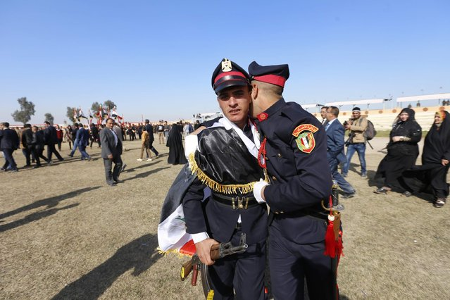 Officers react at their graduation ceremony during Iraqi Army Day anniversary celebration in Baghdad January 6, 2015. (Photo by Thaier al-Sudani/Reuters)