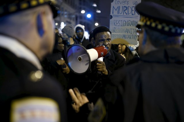 Protesters confront police officers during a protest in response to the fatal shooting of Laquan McDonald in Chicago, Illinois, November 25, 2015. (Photo by Andrew Nelles/Reuters)