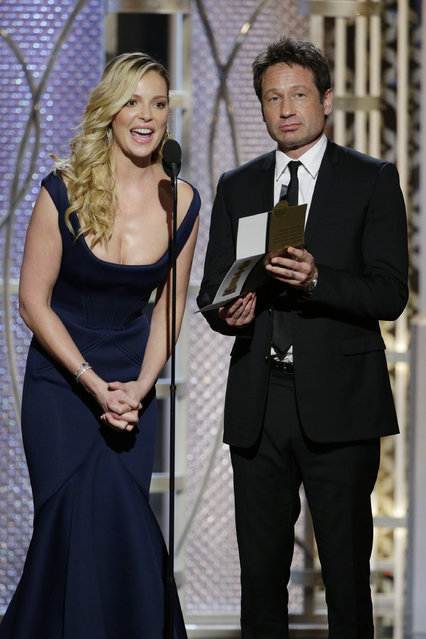 In this handout photo provided by NBCUniversal, Presenters Katherine Heigl and David Duchovny speak onstage during the 72nd Annual Golden Globe Awards at The Beverly Hilton Hotel on January 11, 2015 in Beverly Hills, California. (Photo by Paul Drinkwater/NBCUniversal via Getty Images)