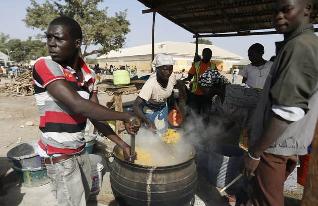 People fleeing Boko Haram violence in the northeast region of Nigeria, cook food at Maikohi secondary school camp for internally displaced persons (IDP) in Yola, Adamawa State January 13, 2015. (Photo by Afolabi Sotunde/Reuters)