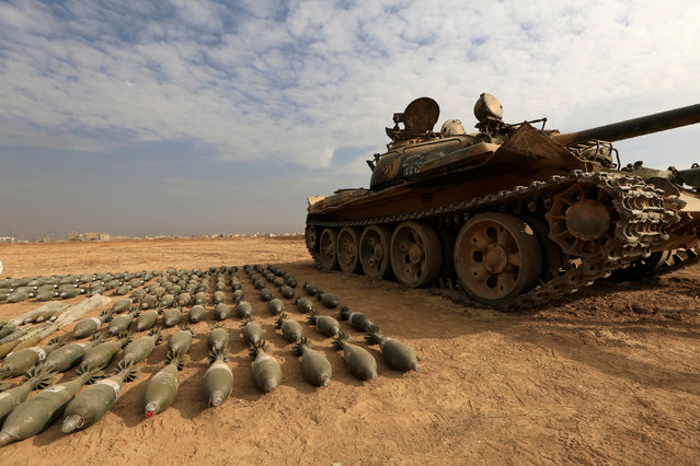 A captured Islamic State tank and shells are seen at the Iraqi army base in Qaraqosh, east of Mosul, Iraq November 8, 2016. (Photo by Zohra Bensemra/Reuters)
