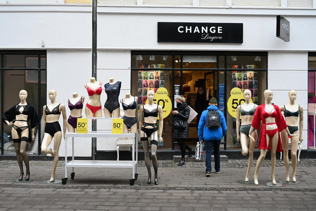 Customers are seen in front of a shop that reopened in central Copenhagen, Denmark, 01 March 2021. Shops reopened after several months of closure due to the coronavirus COVID-19  pandemic. (Photo by Philip Davali/EPA/EFE)