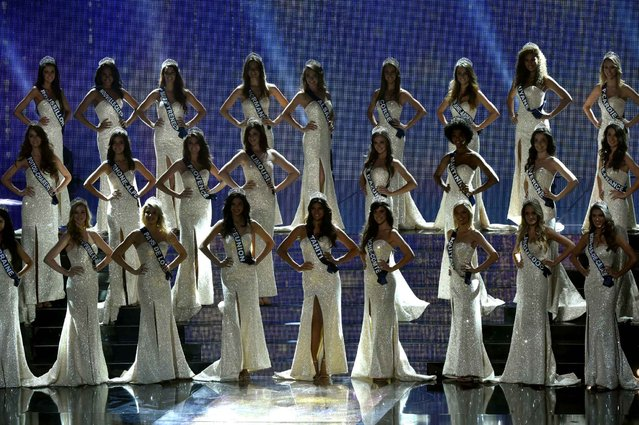 Miss France contestants stand on stage during the Miss France 2016 beauty pageant, on December 19, 2015 in Lille, northern France. (Photo by Philippe Huguen/AFP Photo)