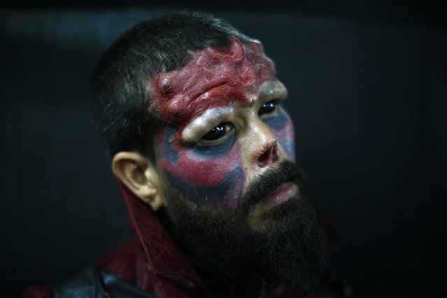 A body modification artist known as Red Skull poses for a picture at Venezuela Expo Tattoo in Caracas January 29, 2015. (Photo by Jorge Silva/Reuters)