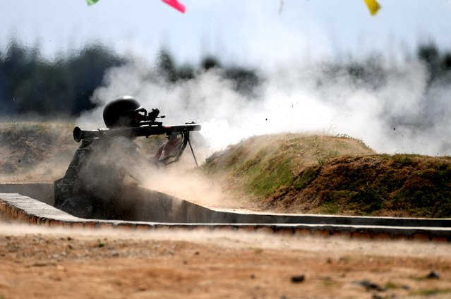 "A Chinese team member fires a rocket launcher in the survival trail event of the International Army Games 2018 ""Seaborne Assault"" on August 2, 2018 in Quanzhou, Fujian Province of China. (Photo by Wang Dongming/China News Service/VCG via Getty Images)"