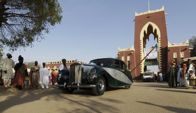 A classic vintage car drives out of the Emir of Kano's palace during the coronation of the new Emir Muhamadu Sanusi II in Kano, Kano State, February 7, 2015. (Photo by Afolabi Sotunde/Reuters)